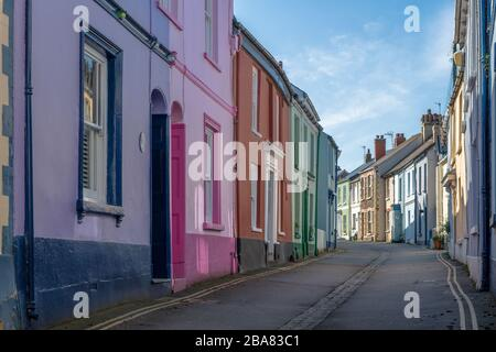 The quaint little colourful cottages on Irsha Street in the North Devon seaside village of Appledore are a mixture of holiday rentals and homes for lo - Stock Photo