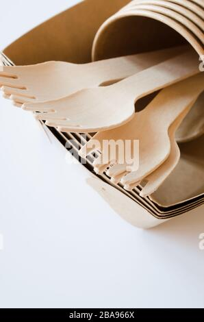 Eco-friendly biodegradable cardboard or paper dishes on white background. Zero waste recycling concept. Catering and street fast food paper cups, plat - Stock Photo