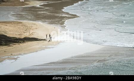 A panoramic view of incoming tide at Crantock Beach in Newquay in Cornwall. - Stock Photo