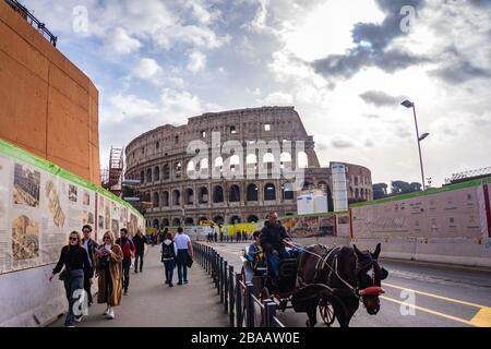 Colosseum in Rome, Italy. Ancient Roman Colosseum is one of the main tourist attractions in Europe. People visit the famous Colosseum in Roma center. - Stock Photo