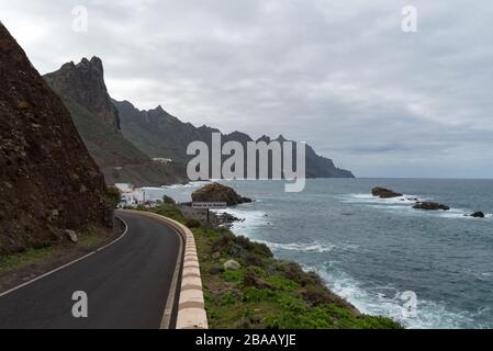 Roque de Las Bodegas, Tenerife,  -Jaunary 11, 2020: View to waves and cliff near Roque de Las Bodegas beach in the area of Taganana from coastline roa - Stock Photo
