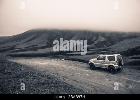 Monochrome of car 4x4 in Highlands of Iceland, driving on dirt road - Stock Photo