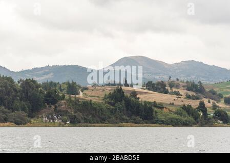 Aquitania, Boyaca / Colombia: April 9, 2018: landscape of Tota, the largest Colombian lake, a cold and cloudy morning - Stock Photo