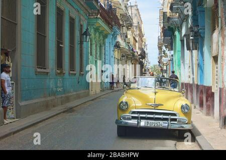 Vintage automobiles and crumbling colonial architecture, Havana, Cuba