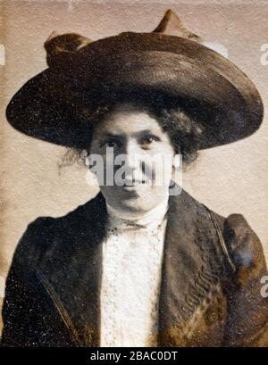 Archive portrait circa 1910 of a young Edwardian woman - printed on textured paper. - Stock Photo