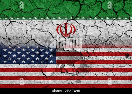 Flag of USA and Iran on cracked concrete wall background. Concept of Conflict between war America vs Iran