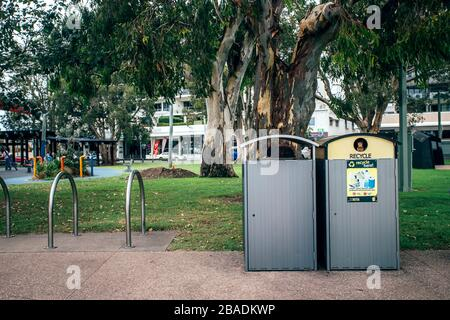 Maroochydore, Australia, March 6, 2020. Rubbish bins for public place. Different Bins For Collection Of Recycle Materials in the park. - Stock Photo