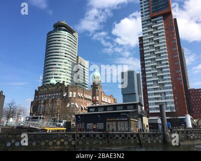 Rotterdam, Kop van Zuid, The Netherlands-May 2019; low angle view of the iconic former office building of the Holland America Lines (Nederlandsch Amer - Stock Photo