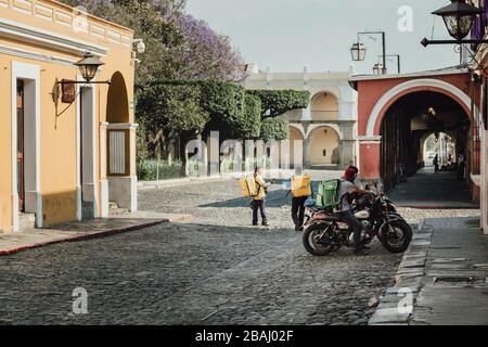 Empty streets as curfew begins in colonial Antigua Guatemala, a popular tourist destination, businesses closed due to coronavirus pandemic quarantine