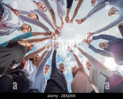 Friendly friends spread their hands. The concept of strong friendship. - Stock Photo
