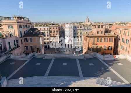 ROME, ITALY - 12 March 2020: A street cleaner climbs down the popular Spanish Steps, deserted today, a rare sight in Rome, Italy. The Italian governme