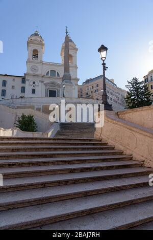 ROME, ITALY - 12 March 2020: the popular Spanish Steps are deserted, a rare sight in Rome, Italy. Today, the Italian government decreed a nationwide l
