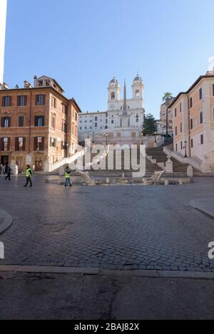 ROME, ITALY - 12 March 2020: Police enforce the confinement measures at the Spanish Steps, Rome, Italy. Today, the Italian government decreed a nation