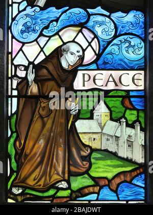 Stained Glass Window Showing St Seiriol a Medieval Welsh Saint who created a cell at Penmon Priory on Anglesey - Stock Photo