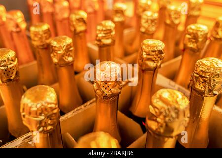 wine Golden bottle necks, close-up of a box of champagne. - Stock Photo