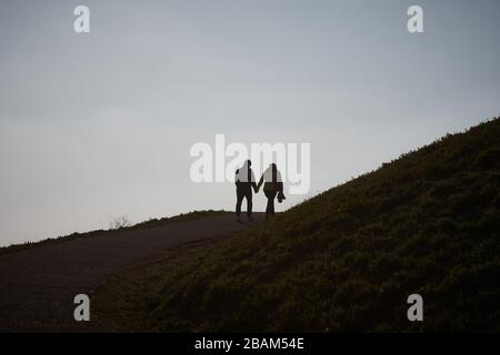 Dortmund, Germany. 28th Mar, 2020. In the afternoon, walkers are out on the slagheap at Phoenix Lake in springtime weather. To contain the coronavirus, NRW has banned all accumulations of three or more people in public. Credit: Bernd Thissen/dpa/Alamy Live News Credit: dpa picture alliance/Alamy Live News Credit: dpa picture alliance/Alamy Live News - Stock Photo
