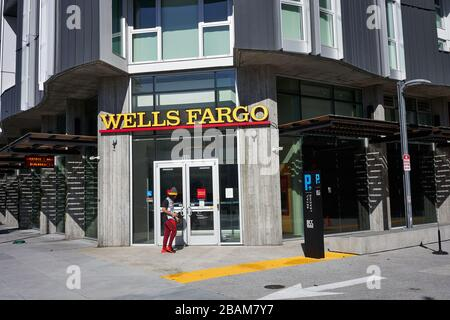 A man walks past a branch of Wells Fargo Bank in the SoMa District of San Francisco, California, on Sunday, Feb 9, 2020.