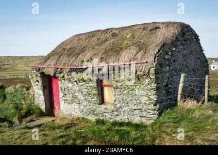 Donegal, Ireland - Mar 22, 2020: This is an old abandon thatched cottage in Donegal Ireland