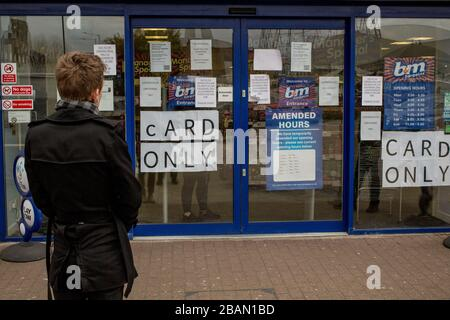 London UK 28th March 2020 A  B&M's, shop accepting card payments only in the face of the coronavirus pandemic. - Stock Photo