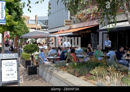 Numerous cafes offer outdoor dining along the Thames Riverside Quay in Kingston Upon Thames, England.