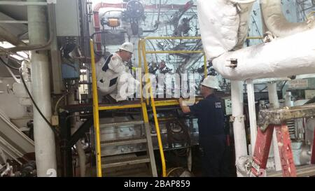 Norfolk, USA. 28th Mar, 2020. NORFOLK, VA - MARCH 23: U.S. Coast Guardsmen from the Coast Guard Sector Virginia Prevention Department inspect the engine room of the Military Sealift Command hospital ship USNS Comfort (T-AH 20) at Naval Station Norfolk, Virginia, March 23, 2020, before its departure to New York to assist in the response to COVID-19. Credit: Storms Media Group/Alamy Live News - Stock Photo