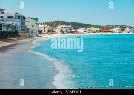 Buoyed off swimming areas in the blue waters of Grand Case Beach, Saint Martin (French side) - Stock Photo