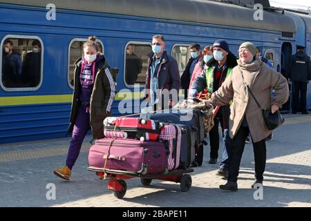 ATTENTION EDITORS! WRONG LOCATION GIVEN AT THE BEGINNING OF CAPTIONS FOR TASS IMAGES ID TS0D3A7F; TS0D3A7D; TS0D3A7C; TS0D3A7B; TS0D3A7A, DATED 28 MARCH 2020, TITLED 'Russia repatriates its citizens from Ukraine amid COVID-19 pandemic', BY VLADIMIR GERDO. THE PICTURES SHOW A TRAIN STATION IN MOSCOW, NOT KIEV. EXAMPLE OF CORRECTED CAPTION FOLLOWS: 'MOSCOW, RUSSIA - MARCH 28, 2020: People in face masks push a luggage trolley at Moscow's Kiyevsky Railway Station after the arrival of a special train which took Russian citizens from Kiev, Ukraine. Russia and Ukraine have agreed a deal to briefly re - Stock Photo