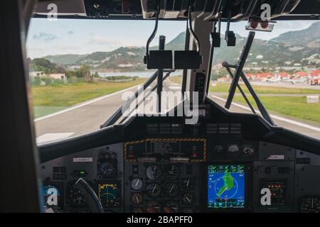 View from the cockpit of a Twin Otter lined up for takeoff on runway 10 at Gustaf III Airport, Saint Barthélemy - Stock Photo