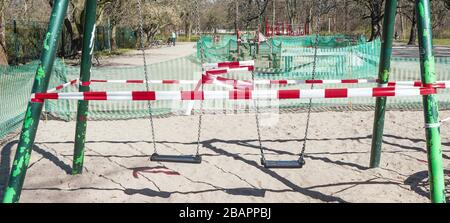 The image was taken in Leipzig, eastern germany. It shows a closed playground during the time of corona quarantene. Children are not allowed to play.