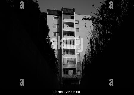 Kranj, Slovenia, March 20, 2020: A view of an apartment building during the coronavirus outbreak nationwide lockdown when people are asked to stay at home. - Stock Photo