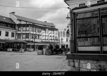 Kranj, Slovenia, March 22, 2020: The empty old city center of Kranj, Slovenia, during the coronavirus outbreak nationwide lockdown. - Stock Photo