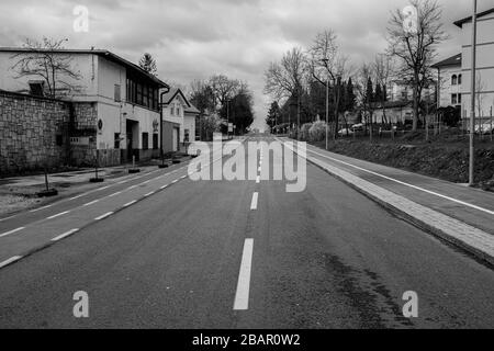 Kranj, Slovenia, March 22, 2020: An empty road and sidewalks in the town of Kranj, Slovenia, during the coronavirus outbreak nationwide lockdown. - Stock Photo