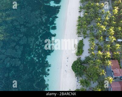 Aerial  top down view of Algeria Beach on a tropical paradise island of Siargao, Philippines