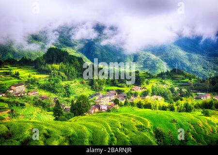 Clouds hanging over the Yunhe cloud rice terraces in the summer in Zhejiang province China. - Stock Photo