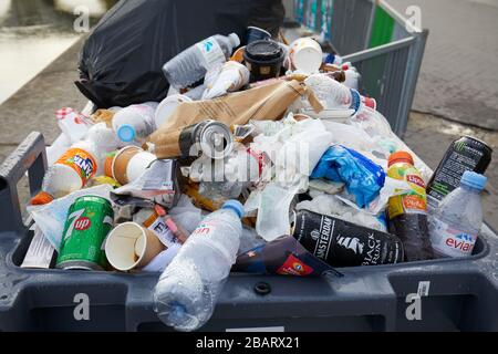 PARIS - NOVEMBER 8, 2019: Full trash bin with colorful rubbish in Paris - Stock Photo