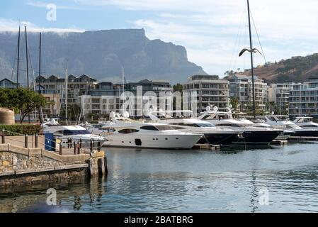 Cape Town, South Africa, Dec 2019. Luxury yachts and properties on the waterfront with a background of Table Mountain central Cape Town, South Africa - Stock Photo