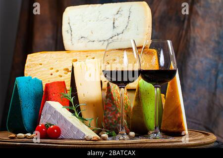 Different sorts of cheese on kitchen table - Stock Photo