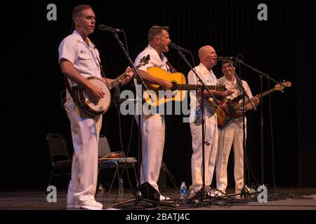 'Country Current bluegrass ensemble entertains a crowd in Spindale, North Carolina, at the Performing Arts Center of Isothermal Community College.; 17 August 2017, 07:11; 170817-N-NW255-39; United States Navy Band from Washington, D.C., USA; '