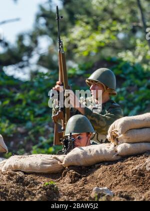 Reviving history actors of Slovenia Pivka museum of military history representing Russian Army soldiers in Afganistan - Stock Photo