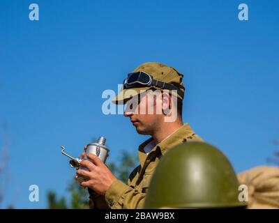 Reviving history actors of Slovenia Pivka museum of military history representing Russian Army soldier in Afganistan - Stock Photo