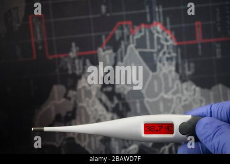 Showing 38.7 C Celsius against world map dark background. Path selection included.Doctor hand with blue medical gloves is holding digital thermometer