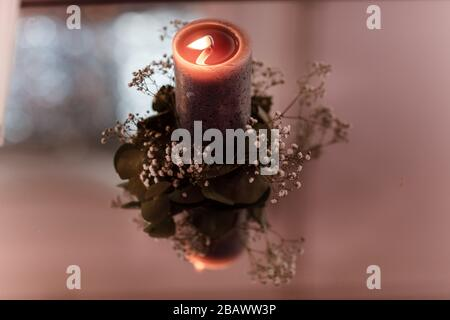 Beautiful composition with burning candles and flowers on mirror table. copy space, selective focus - Stock Photo