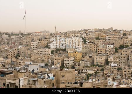 The old city of Amman, Jordan, with tha Raghadan Flagpole, one of the tallest free-standing flagpoles in the world, in the background. - Stock Photo