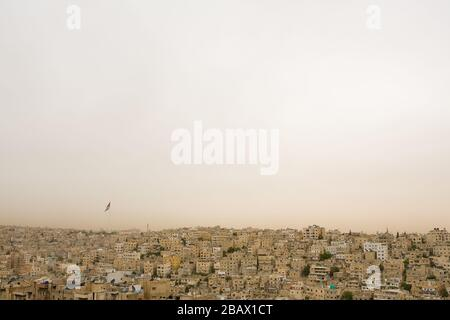 The densely populated area of the old city of Amman, Jordan, and the Raghadan Flagpole, one of the tallest free-standing flagpoles in the world. - Stock Photo