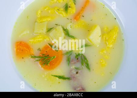 Potato cream soup with mushrooms, carrots and cheese. Top view. Close up