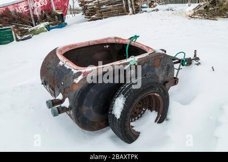 Cliver oil tank trailer for ATV or Ski-Doo at the home of Desmond Adams in Joe Batt's Arm on Fogo Island, Newfoundland, Canada [No property release; a - Stock Photo