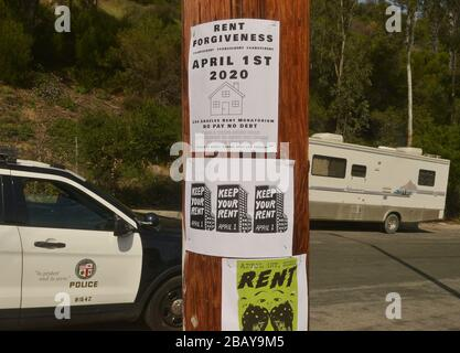 Los Angeles, California, USA. 30th Mar, 2020. Los Angeles, United States. 29th Mar, 2020. A sign calls for a rent moratorium near a self-testing coronavirus site in Los Angeles on Saturday, March 28, 2020. Photo by Jim Ruymen/UPI Credit: UPI/Alamy Live News Credit: UPI/Alamy Live News - Stock Photo