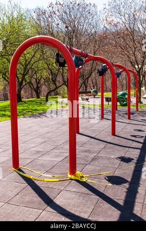 Playground equipment roped off to not be used with the Coronavirus pandemic in city owned Frick Park, Pittsburgh, Pennsylvania, USA - Stock Photo