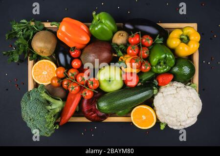 Large selection of raw fruits and vegetables in box - Stock Photo