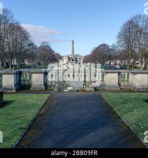 Port Sunlight Hillsborough disaster Memorial Garden to 96 football supporters, with village war memorial and Lady Lever Art Gallery in the background. - Stock Photo